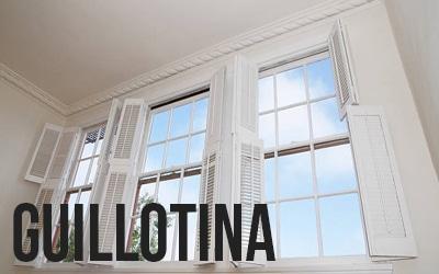 ventana guillotina con contraventana